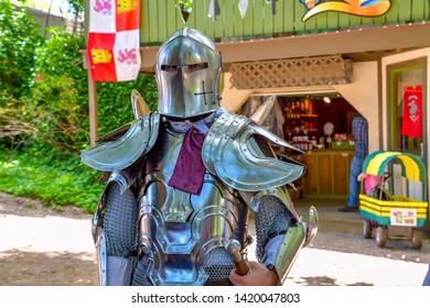 Knight in shining armor standing guard.