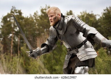 Knight with sword defending himself