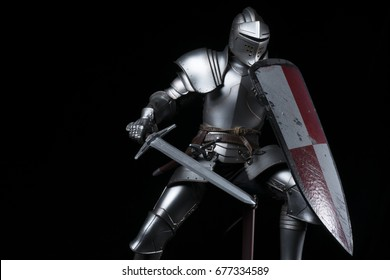Knight with sword and red and white shield