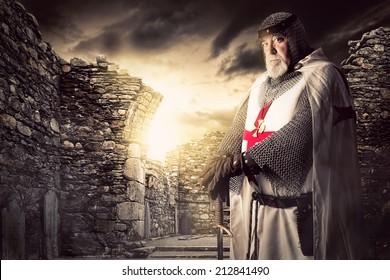 Knight Templar posing near some ruins