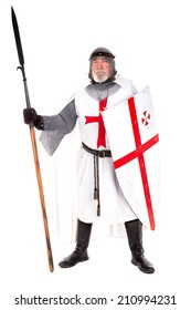 Knight Templar posing with shield and spear isolated in white