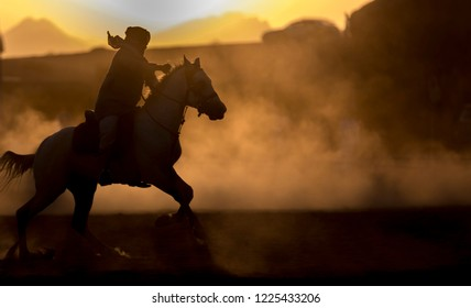 Knight trains his horses before sunset