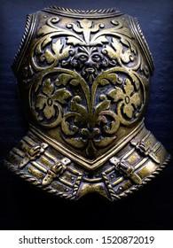 Knightly armor on a black background