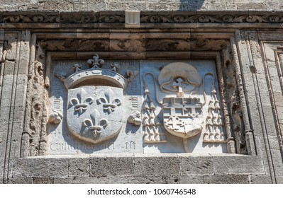 Knightly coat of arms on the wall of a house of Ippoton street in Rhodes island, Greece