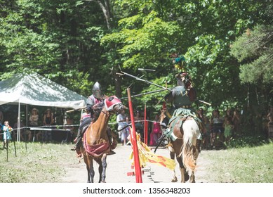 Knights in a joust at a festival