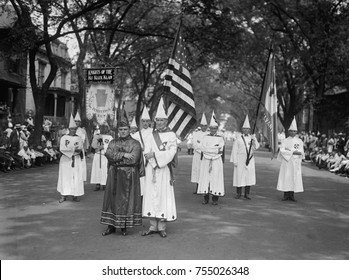 Knights of the Ku Klux Klan from the 'Pennsylvania Realm' pause for a news photographer. They were among the 25,000 to 35,000 who marched unmasked in the big parade on Pennsylvania Avenue on August 8,