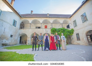 Knights and princesses are standing inside the courtyard