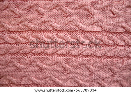 2ab50171938 Knit texture of pink wool knitted fabric with cable pattern. Place for text.