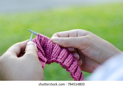 Knit with two blurred hands