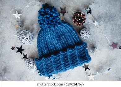 Knit Wool Hat with Pom Pom. Flat lay fashion winter background