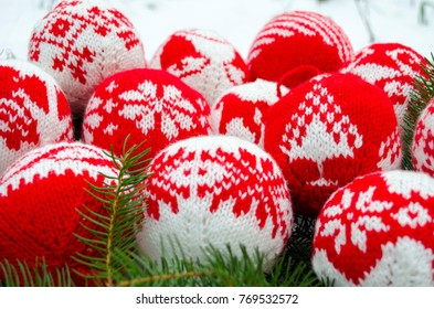 Knitted balls with ornament for new year tree decoration