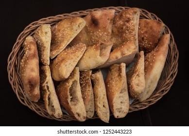 a knitted basket full of fresh fragrant buns
