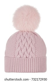 Knitted beautiful pink woolen hat with fur pompon ball, close-knit, isolated on white background