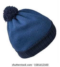 knitted blue  hat isolated on white background.hat with dark blue  pompon .