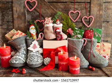 Knitted boots with little presents and candy for Christmas
