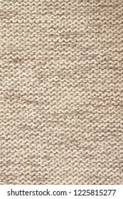 Knitted cloth purl stitch texture of melange neutral colored linen yarn.