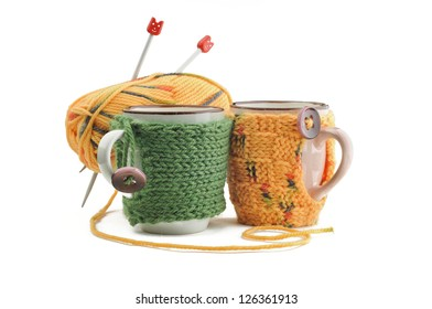 Knitted cup, ball of yarn