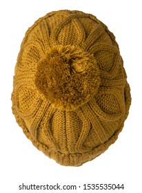 knitted dark yellow hat isolated on white background.hat with pompon top view.