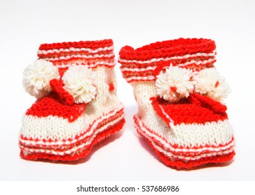 Knitted handmade booties on a white background.