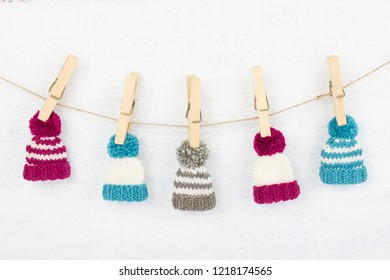 Knitted hat on wooden clothespins