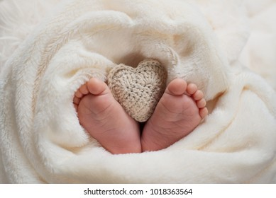knitted heart in a little foots