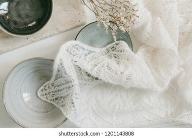 Knitted lace scarf on wooden table