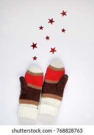 knitted mittens isolated on white background with stars