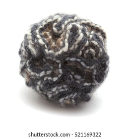 knitted pompom of variegated yarn isolated on white