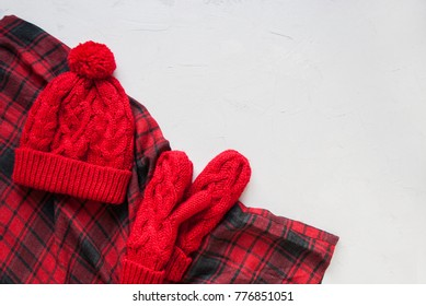 0a334acddd6 Knitted Red Hat Mitten Checkered Plaid Holiday Christmas Background Copy  Space Happy New Year Greeting Card