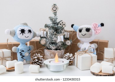 Knitted Robot. New Year's and Christmas card. Christmas tree and gifts boxes. Huggy concept. Concept. DIY.