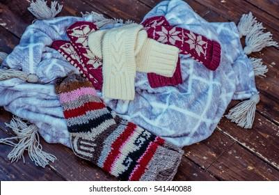 knitted socks on a dark floor