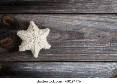 Knitted stars on on a wooden background