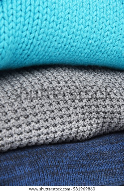 knitted sweaters in the stack