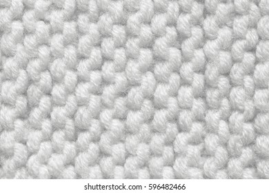 Knitted texture of gray and white color. Background for a festive winter postcard.