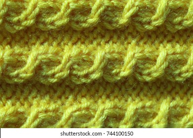 Knitted texture of handmade products. A fashionable color palette is Golden Lime.
