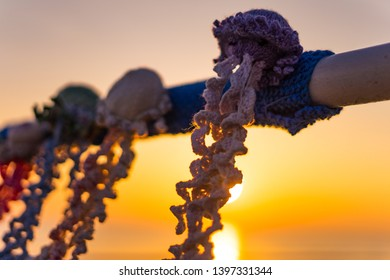 Knitted toys attached to Saltburn pier. Sunrise on the north east coast of England.