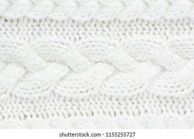 Knitted warm white winter sweater. Huggy style.