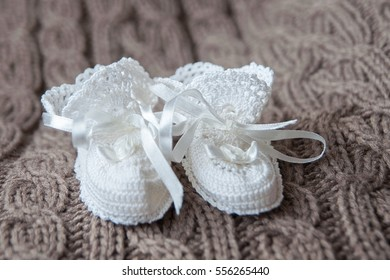 Knitted white little shoes