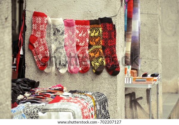 A lot of knitted woolen socks with patterns sold on the street.