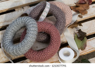 Knitted wreath base on wooden background