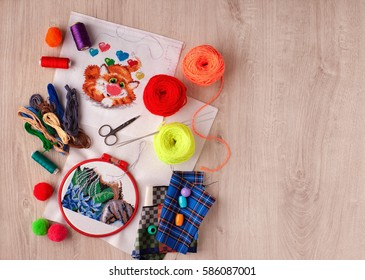 Knitting and embroidery. Knitting and embroidery are the creativity and the arts. tangles yarn for knitting clothing. Embroidery is made to the embroidery frame. Objects for needlework and handmade.