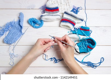 Knitting. Hand Crochet.  Female hand knit hook. Top view.
