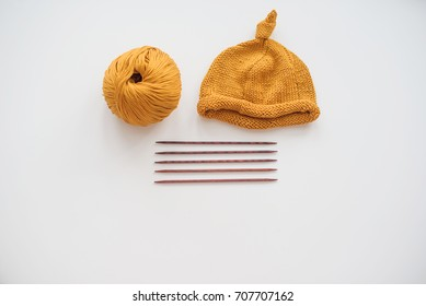 knitting hat by needles for baby