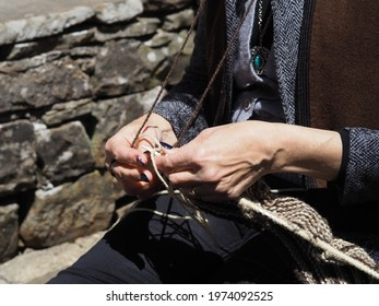 Woman with hooks for hands