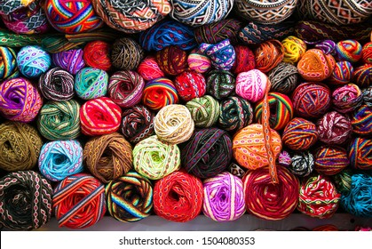 Knitting needles, colorful threads. Knitting pattern of colorful yarn wool on shopfront. Knitting background. Knitting yarn for handmade winter clothes. Cusco , Peru, South America.