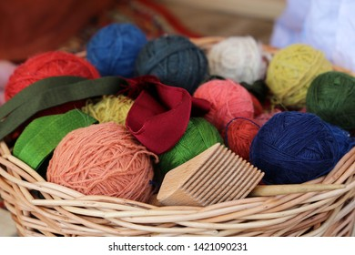 Knitting and needlework, wicker basket with colorful skeins of yarn