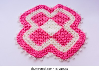 Knitting texture pattern with colors fuchsia and white