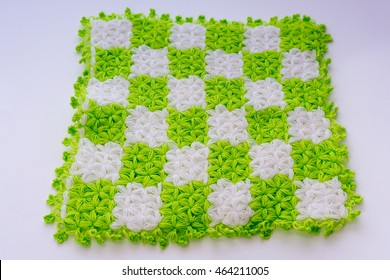 Knitting texture pattern with colors green and white