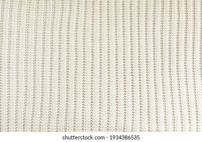 Knitting. Vertical striped knitted fabric texture. Background.