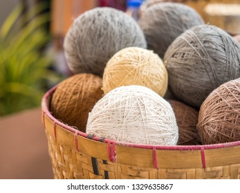 Knitting wool earth tone color in basket, material for handmade hobby. Selective focus.